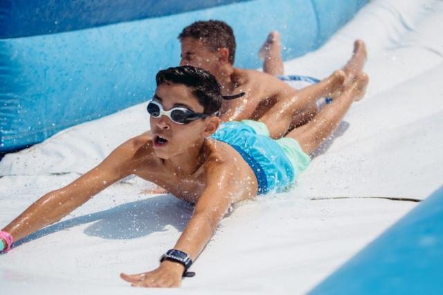 boy on slide at lake geneva