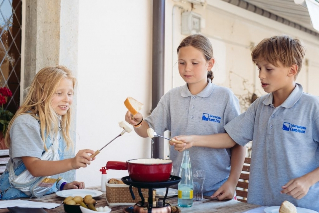 children trying fondue in Gruyere