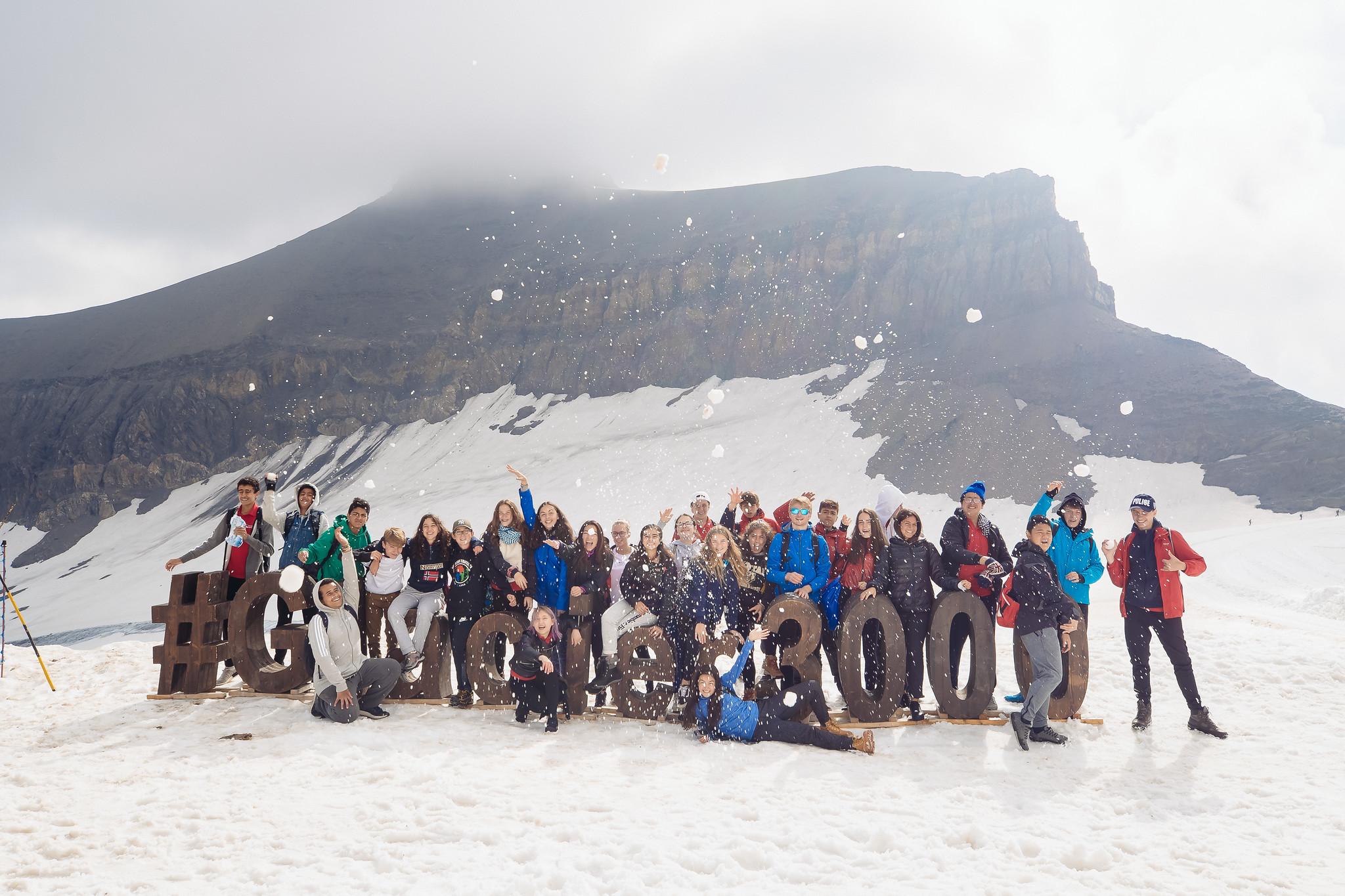 group throwing snowballs at Glacier 3000
